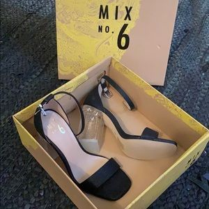 Cute black strapy heels.